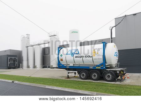 OLDENZAAL NETHERLANDS - JANUARY 1 2016: Exterior of a food processing factory with a trailer with chemical liquids in front