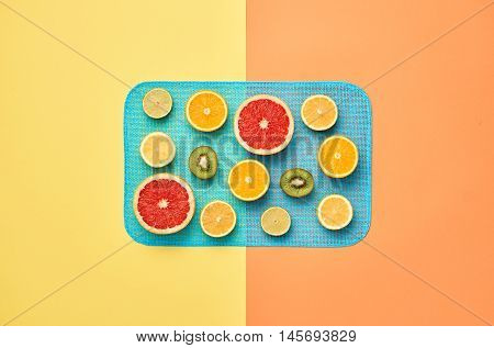 Fashion. Tropical Fruit Citrus Orange Grapefruit Lime Kiwi. Bright Color. Creative Art. Minimal. Fashion creative. Summer Beach Concept. Minimal