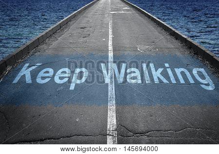 Keep walking message on empty road
