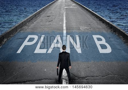 Plan B message on road and business man