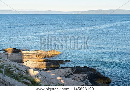 Rocky beach and bue sea in Istria, Croatian coast