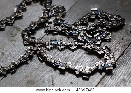 chain from a chainsaw on a wooden floor