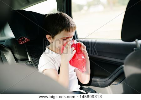 Seven Years Old Child Vomiting In Car