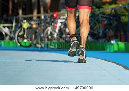 Running triathlete in the transition zone extreme sport