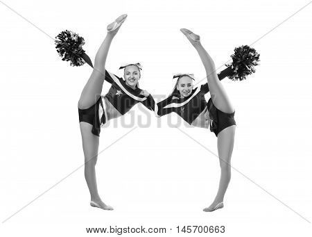 Two professional cheerleaders posing at studio. Vertical split. Isolated over white.Black and white photography