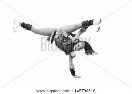 Young Professional Cheerleader Dressed In A Warrior Costume Standing On One Hand. Horizontal Splits