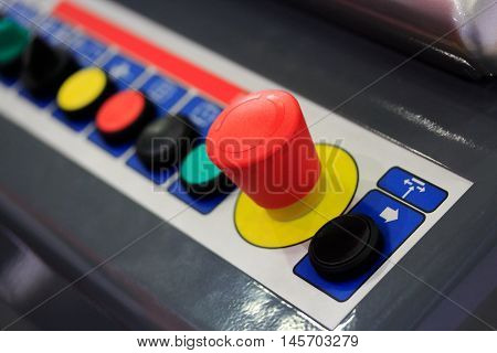 Push buttons on operation panel of industrial machinery.