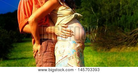 pregnant woman belly closeup, natural ethno lifestyle