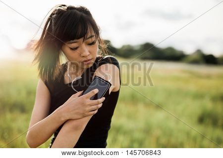 Fitness Female Checking Her Performance On Smartphone
