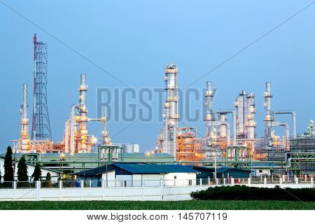 Architecture of Oil Refinery Plant with distillation tower with Sunset Twilight