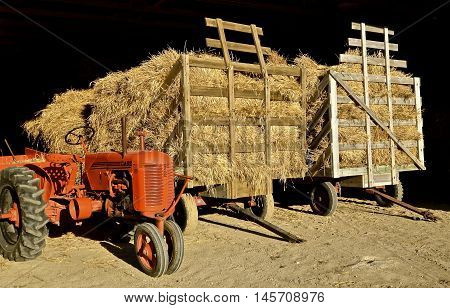 ROLLAG, MINNESOTA, Sept 1, 2016: An old Case tractor is parked by hay racks of wheat bundles at the West Central Steam Threshers Reunion(WCSTR) where 1000s attend each Labor Day weekend in Rollag, MN each year.