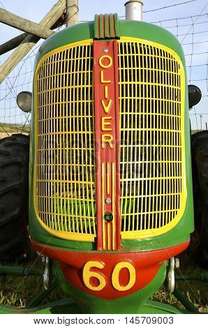 ROLLAG, MINNESOTA, Sept 1, 2016: An old restored Oliver 60 tractor and grill is displayed at the West Central Steam Threshers Reunion(WCSTR) where 1000s attend each Labor Day weekend in Rollag, MN each year.