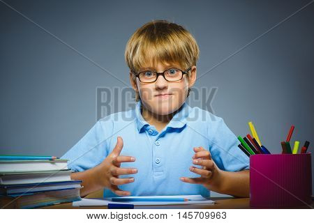 school concept. Closeup gestured child on grey, boy found idea or solution