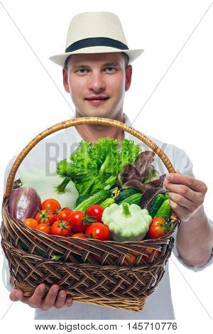 basket of ripe vegetables at the farmer's hands