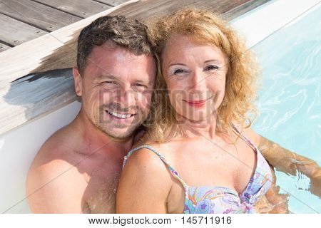 Man And Woman In Swimsuit At The Pool