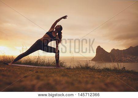 Woman Practicing Utthita Parsvakonasana Yoga Asana