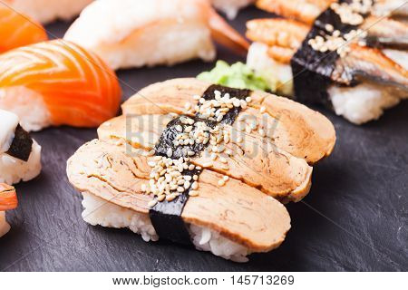 Close-up of Tamago sushi with omelet and wasabi
