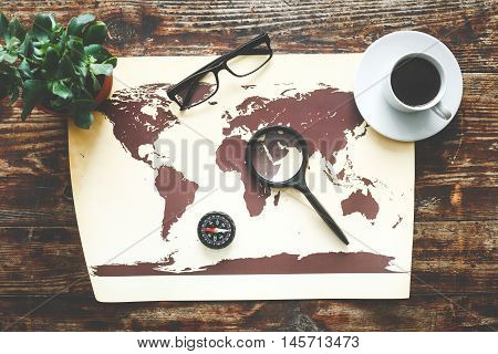 world map on a wooden table time to travel top view