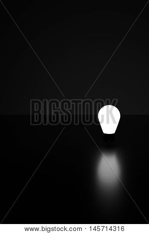 light bulb in the dark with a shadow on glossy glass,think idea concept,light in the dark,3d rendering illustration