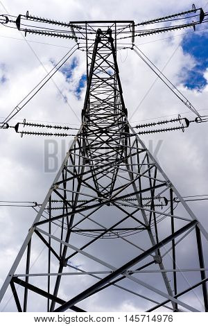 Electrical Transmission line tower close-up view from below