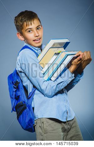 school concept. portrait successful happy boy with knapsack holding books.