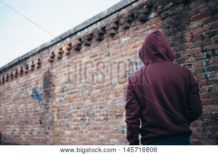 Young Boy Lonely In Urban Street