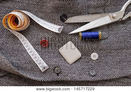 Tailor various tools isolated on textile background
