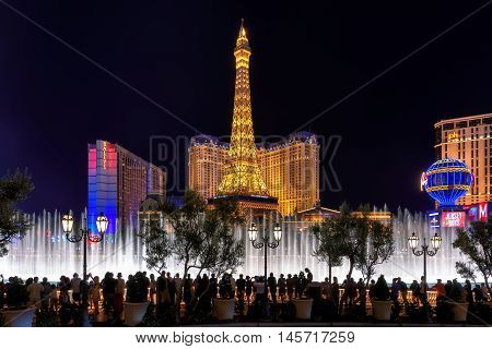 People enjoy Bellagio fountain show at Paris hotel and casino in Las Vegas