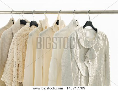 Set of female dress with,coat isolated on hanging