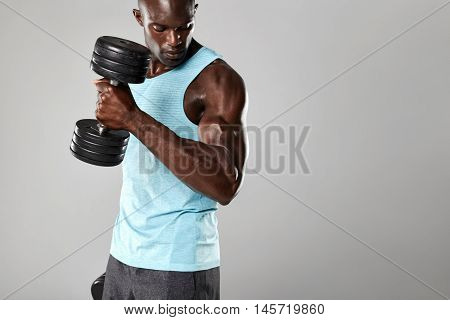 Fit And Young Man Working Out With Dumbbells