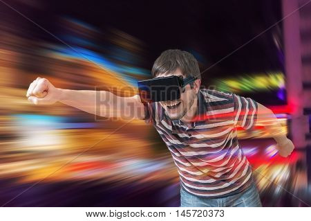 Happy Young Man Is Playing Racing Videogame In 3D Virtual Realit
