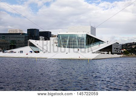 OSLO, NORWAY - JULY 2, 2013: The Opera House in Oslo Norway. The building is situated in the central Oslo at the head of the Oslofjord. It was built in 2007 and was opened on April 12 2008.