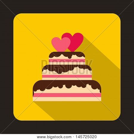 Wedding cake with two pink hearts icon in flat style on a yellow background vector illustration