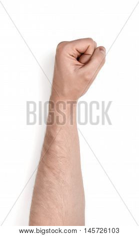 Close up view of a man's hand clenched into a fist, isolated on white background. Body language. Gestures.