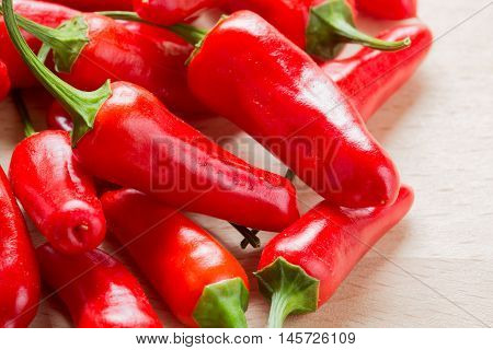 Red chilli pepper 'capsicum annuum' on a wooden chopping board