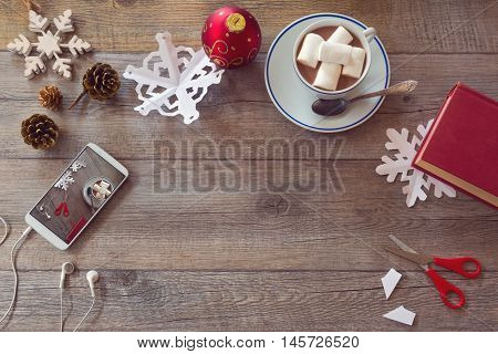 Christmas holiday celebration. Preparing paper snowflakes. View from above with copy space