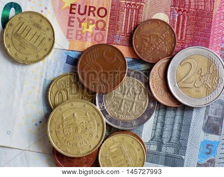 Euro coins on euro banknote, finance crisis