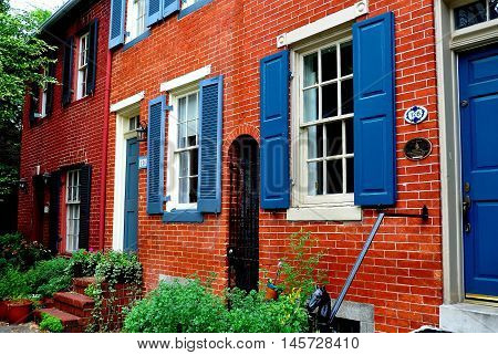 Baltimore Maryland - July 23 2013: Handsome late 18th and early 19th century homes line Montgomerey Street in the Federal Hill National Historic District
