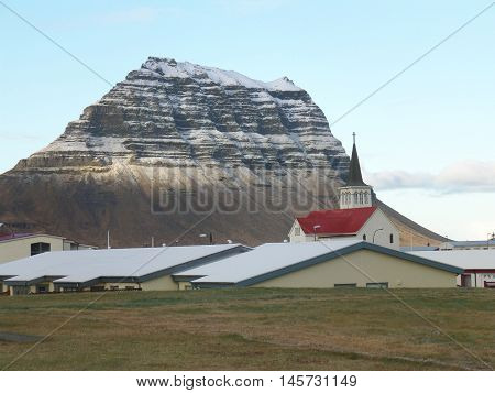 Snow Capped Kirkjufell Mountain seen from the Town of Grundarfjordur, Iceland