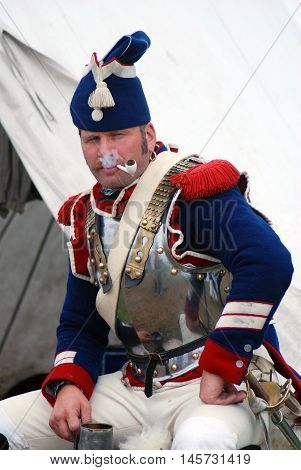 BORODINO MOSCOW REGION - SEPTEMBER 04 2016: Reenactor dressed as Napoleonic war French soldier at Borodino battle historical reenactment in Russia. Color photo.