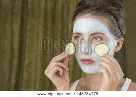 young woman taking care of her complexion layering moisturizer