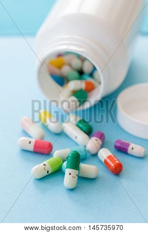 Colorful pills with happy faces mental health concept