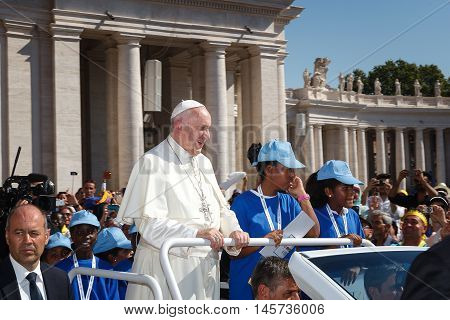 Vatican City - September 3, 2016: Pope Francis on the new convertible, surrounded by a crowd of faithful flocked to St. Peter's Square for the celebration of the beatification of Mother Teresa of Calcutta.
