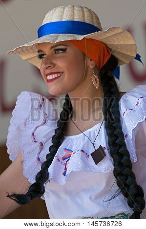 TIMISOARA ROMANIA - JULY 102016:Young woman from Costa Rica in traditional costumepresent at the international folk festival