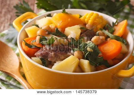 South American Cuisine: Puchero Soup With Chickpeas Close-up In A Pot. Horizontal