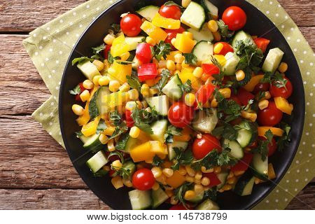 Low Calorie Salad Of Corn, Tomatoes, Cucumbers And Pepper Closeup. Horizontal Top View