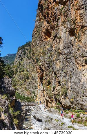 Samaria Gorge, Grece - May 26, 2016: Tourists Hike In Samaria Gorge In Central Crete, Greece. The Na
