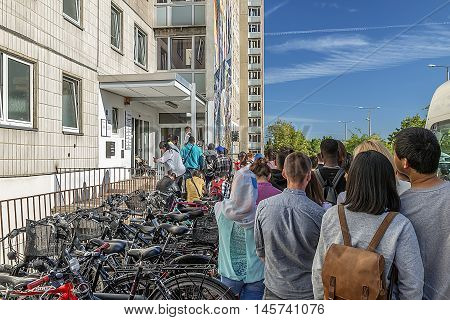 Group Workers standing in line at the Migration Service, Germany, Halle, 08.30.2016 - 9:01:32