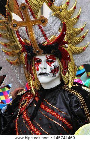 Cajamarca Peru - February 7 2016: Close up of frightening masked figure in Carnival parade in Cajamarca Peru on February 7 2016