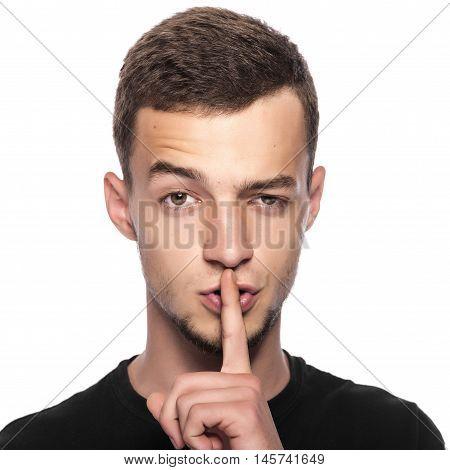 Man gesturing silence, quiet, on white background.